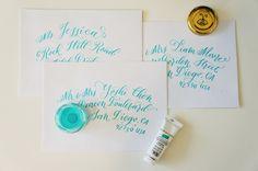 Grey ink on pink envelope wedding calligraphy modern calligraphy