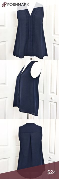 """Monteau Tank/Blouse Lightweight top by Monteau, navy blue in color.  Features a v neckline and tuxedo style front.  EUC.  Worn once.  Material is made of 100% polyester.  Measurements laid flat: bust 19"""" and length from top of shoulder to hem in front 24"""" and back 28"""". Monteau Tops Tank Tops"""