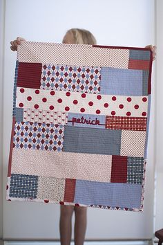 quilt - good way to use scraps.  I like the uneven linear look instead of patchwork squares