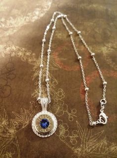 38 special bullet pendant with sapphire blue swarovski crystal gem in center on sterling silver chain! Check out this item in my Etsy shop https://www.etsy.com/listing/244144222/38-special-bullet-necklacefederal-38