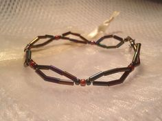 Beaded bracelet - copper, purple, red & blue - handmade from bugles and quality Japanese seed beads. Inc. cream organza gift bag. on Etsy, $9.95 AUD