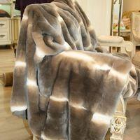 Меховой плед Орилаг 2 800 000 руб. Плед выполнен из натурального меха орилаг на козьей подкладке, 15 микрон, 8-10 тысяч ворсинок на кв.см. Цвет коричневый, серый.