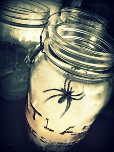 HOW TO: Turn your LED tealight on and place it in the bottom of your jar.  Lightly stuff some spider webbing into the jar, hiding the tea light as much as possible.  Top with a plastic spider.  Voila! Now you can set these along your sidewalk as spooky luminarias or you can tuck them into dark corners in your house to add a little ambience.