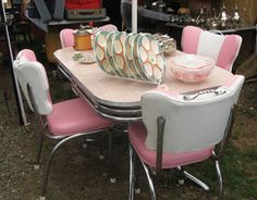 A Pristine Chrome Kitchen Table With Pink Formica Top Accompanied By And White Vinyl Chairs