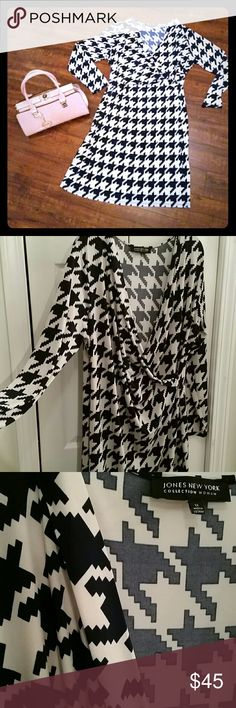 Hounds tooth dress Beautiful dark navy and white hounds tooth mock wrap style dress from Jones New York Collection. Size 1X. 94% polyester 4% spandex  Slimming style has stretch. Worn only once. Perfect for the office or out to dinner. Jones New York Dresses