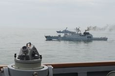 BLACK SEA (June 13, 2016) Romanian navy ships NMS Contraamiral Horia Macellariu (F-265), front, and Lăstaunul (F-190) conduct passing exercise with USS Porter (DDG 78) in Black Sea June 13, 2016. Porter, an Arleigh Burke-class guided-missile destroyer, forward-deployed to Rota, Spain, conducting routine patrol in U.S. 6th Fleet area of operations in support of U.S. national security interests in Europe. (U.S. Navy photo by Mass Communication Specialist 3rd  Class Robert S. Price)