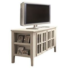 Media console with adjustable shelves and four glass doors.