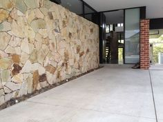 Eco Outdoor Crackenback freeform stone wall at home entrance, design by Aktis Architects. | Eco Outdoor | Crackenback…