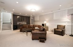 Traditional Basement with flush light, Crown molding, Built-in bookshelf, Wainscoting, Carpet
