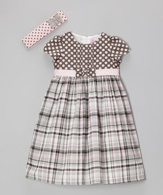 A striking cut and charming colors combine for a perfectly girly frock. Featuring comfy construction and an easy-on fit, this piece is dressed up with a vibrant bow accent and matching headband.