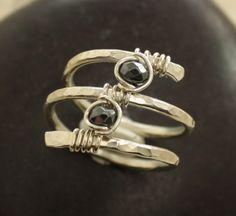On the slim chance that I ever get married, I'd love a wedding ring designed like this, with each of our favorite stones.