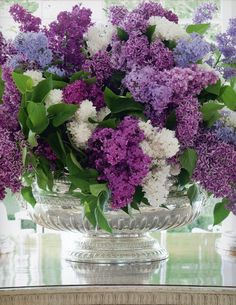 A centerpiece of gorgeous lilacs by Carolyne Roehm.