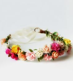 A romantic adornment for any occasion, this paper flower crown is ringed with carnations, roses and peonies.