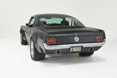 1965 Mustang Fastback Restomod - Rear shot shows fender flairs well.