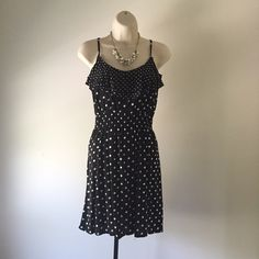 ELLE Ruffled Polka Dot Dress Gathered elasticized waist, adjustable spaghetti straps, and best of all - it has pockets!!!!  Looks fabulous through all seasons. Pair with a chunky cardigan and boots for fall, or bare your shoulders during summer months. Ruffle detail at bust makes this dress ultra feminine and chic.    Open to all reasonable offers  ☀️ Happy to answer any questions   I ship within 2-4 days unless otherwise requested   Thanks for shopping my closet!  Kelly Elle Dresses