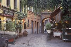 Italy, Rome, Trastevere, street with restaurant tables.