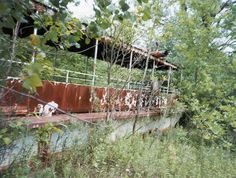 Old ferry boat rotting in the forest at the abandoned Chippewa Lake Amusement Park in Ohio.