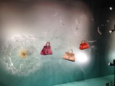 YSL Window Display in Cancun  I just love the Dandelion!  I have videos of it too, as they had a fan on the display so it moved ever so slightly.