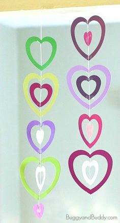 Here's one of the easiest valentine crafts for kids we've done in a while- a paper heart mobile! This paper heart craft is super simple to make and looks so festive hanging up in your home or classroom! Valentines Bricolage, Valentine Crafts For Kids, Valentines Day Activities, Valentines For Kids, Valentine's Day Crafts For Kids, Projects For Kids, Craft Projects, Valentines Decoration, Holiday Decorations