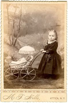 Little girl pushing a doll in a carriage, absolutely charming antique Victorian cabinet card photo.