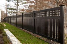 V5215-6 Semi-Privacy Fence with Old English Lattice shown in the Grand Illusions Color Spectrum Black (L105) Custom designed to match a White Victorian Home with black trim. Use Mix 'n' Match to match your fence color with your home accents.
