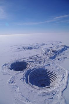 Diavik Diamond Mine, Northwest Territories, Canada. Producing 8 million carats annually the site began production in 2003.  The mine's most remarkable feature is its location, on an island in the middle of Lac de Gras. (V)