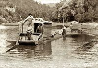 'Narrow Flatboat in Kentucky' ~ circa 1900. Although steamboats pushed ever further up the headwaters of the Appalachian rivers during the nineteenth century, and road and rail access continued to improve, many communities remained isolated, and continued to depend on flatboats as the easiest and least expensive means of transporting farm produce to downriver markets.