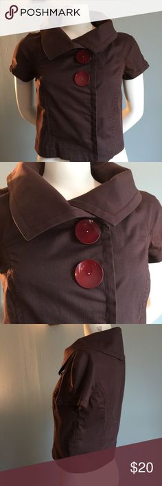 "Short Brown Jacket In good condition, this sweet short-sleeved jacket has oversized buttons. Unlined, made of 98% cotton/2 % polyurethane. Machine wash cold. Bust measures  34"", length from shoulder to hem is 16."" Mint Jackets & Coats"