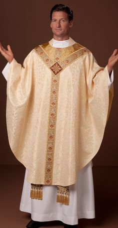 http://www.holyroodguild.com/xcart2/Pascha-Nostrum.html  Early Baroque cut chasuble in ivory quatrefoil damask. St. Andrew's cross orphrey in ivory lotus silk with gold galloon. Embroidered cross medallion. The yoke filled with pale gold Barocco damask.