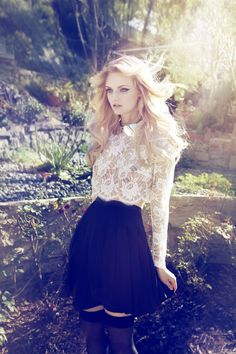 pretty lace top paired with a twirly black mini skirt
