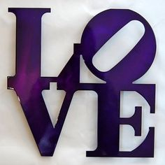 "Purple love sign... I would love to turn the ""o"" into a shamrock in honor of our St. Patrick's Day wedding!"