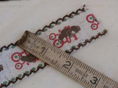 Teddy Bear Ribbon Trim Woven Burlap Type - with bears on bikes.  Red and brown and green.  Sweet for Christmas decorating.