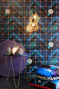 In a new collection of fabric and wallpapers, titled Celeste, Australian Interior Stylist Tim Neve looks to the night sky and beyond. The inky backgrounds of each design were physically created by Tim himself pouring pure pigments of paint across round canvases to create the free-flowing patterns.