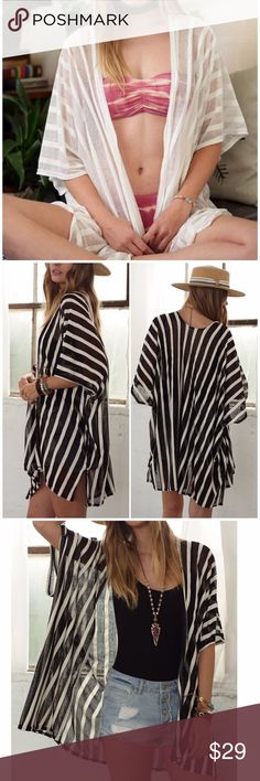 Classic Stripe Sheer Jersey Kimono/ Cover Up Classic Stripe Sheer Jersey Kimono/ Cover Up. 100% polyester. Available in Black and white. Perfect to wear as a cover up or part of your outfit! One size fits most. Fabfindz Swim Coverups