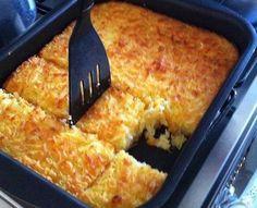 Bolo de Mandioca  Ingredientes 1 prato (fundo) de mandioca crua e ralada 1 pires (chá) de queijo ralado meia cura 1 pires (chá) de coco ralado 2 1/2 copos de açúcar 2 gemas 1 xícara de leite 1 colher (sopa) de fermento em pó 2 colheres (sopa) de manteiga Modo de preparo Misture tudo e leve ao forno a assar em assadeira retangular untada com manteiga Se quiser, faça uma calda rala com 1/4 xícara (chá) de água e 1/2 xícara (chá) de açúcar e despeje no bolo quente, depois de assado.