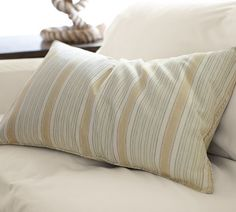 Beach-inspired awning stripes combine with richly textured linen/cotton to create a pillow that's bold but easy to blend with other patterns and solids.