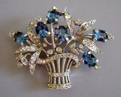 """TRIFARI sterling basket pin with clear and blue rhinestones, circa 1940, 2-1/8""""."""
