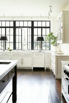 MUST HAVE: STEEL WINDOWS OVERLOOKING COURTYARD FROM KITCHEN SINK