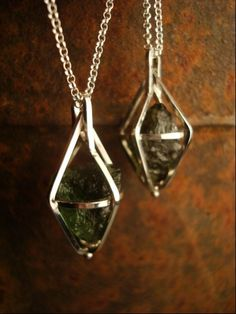 My new favorite obsession in beautiful little cages. Extraterrestrial Moldavite  ThreeCornersDesigns, $95.00