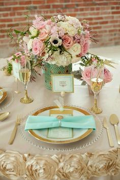 Table setting inspiration in florals, gold, cream, and pink