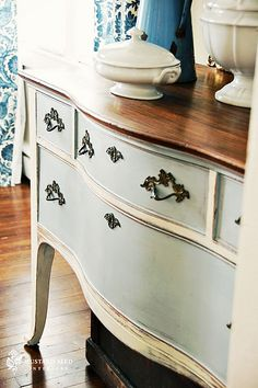 """Here's my rendition of """"How to Stain Furniture"""" I'm working on my most recent project that was inspired by Miss Mustard Seed's French Dresser. On this project, she stained the wood on top of the dresser and I loved the look! I tried staining before and was totally disheartened. I didn't really know what I was doing and just went for it. Guess what happened?? TOTAL FAIL!! I didn't sand enough and it all bubbled and looked awful! 🙁 Oh well, live and learn! I've been researching and watching…"""