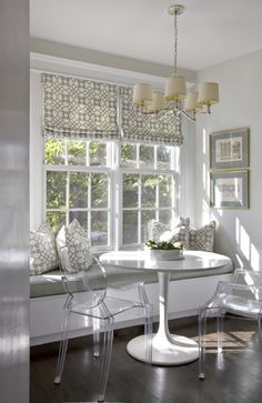 Dining Nook in Gray and White. The Louis Ghost Chairs and Saarinen Table are Sleek and Modern.