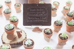 This bride used a rustic chalkboard to write a message to guests about how to take home their unique succulent potted plant wedding favors!  From a rustic wedding we photographed in Columbia, MO at the Country Club!  #succulentwedding #chalkboardwedding #uniquefavors @wildflowerphotography