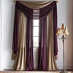 dont love the colors but love the idea of two color curtains for the living room…