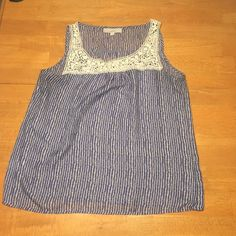 Blue tank with lace detail Sheer tank with cute lace shoulders and fun blue design in great condition LOFT Tops Tank Tops