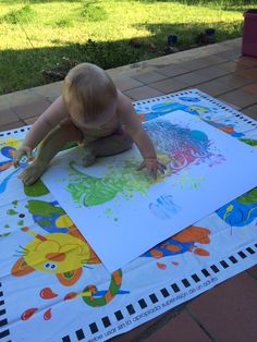 Homemade paint for sensory play with 9 month old - paint made with Greek yogurt and a few drops of food colouring.