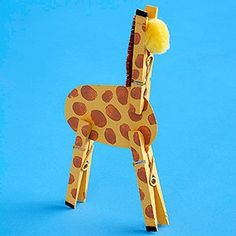 Clothespin Giraffe 1.Cut an oval from chipboard; paint it and three clothespins yellow. Add black paint to the tip of each clothespin as shown. Once the paint has dried, let your child use his fingertips to create brown paint spots all over the oval body and clothespin legs and neck. 2.Clip the legs and neck onto the body and glue in place. Glue a yellow pom-pom face onto the neck and adhere a folded chenille stem along the back of the neck to complete the giraffe.