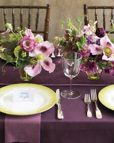 Striking tablescape -  rich, glamorous fabrics in light and dark purples, smooth and textured fabrics