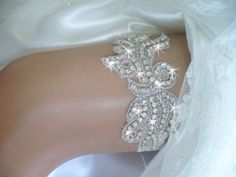 A personal favorite from my Etsy shop https://www.etsy.com/listing/205916296/custom-rhinestone-wedding-garter-bridal