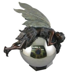 Napco 12-Inch Tall Bronze Fairy on Gazing Ball by Napco. $60.26. Perfect for indoor or outdoor use. 10-inch by 6-3/4-inch by 12-inch. Spruce up your lawn, garden, deck or patio with this decorative ornamental statuette. Made of quality resin for durability and long lasting beauty indoors or out. Our charming bronze fairy with graceful wings, long flowing hair and a petal skirt takes a break while leaning on a gazing ball. Napco has built a uniquely innovative in-house design...
